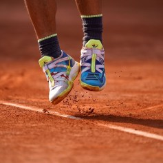 Shoes of Spain's Rafael Nadal as he serves to Japan's Kei Nishikori during their men's singles quarter-final match on day ten of The Roland Garros 2019 French Open tennis tournament in Paris on June 4, 2019. (Photo by Kenzo TRIBOUILLARD / AFP) (Photo credit should read KENZO TRIBOUILLARD/AFP/Getty Images)