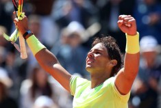 epa07632881 Rafael Nadal of Spain reacts after winning against Roger Federer of Switzerland their men's semi final match during the French Open tennis tournament at Roland Garros in Paris, France, 07 June 2019. EPA/SRDJAN SUKI