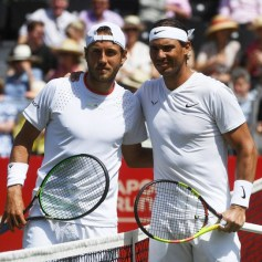 epa07680171 Spain's Rafael Nadal (R) and France's Lucas Pouille pose ahead their match at the Aspall Classic tennis at the Hurlingham club in London, Britain, 28 June 2019. EPA-EFE/FACUNDO ARRIZABALAGA