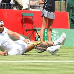 epa07680254 Spain's Rafael Nadal falls during his match against France's Lucas Pouille at the Aspall Classic tennis at the Hurlingham club in London, Britain, 28 June 2019. EPA-EFE/FACUNDO ARRIZABALAGA