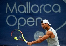 PALMA DE MALLORCA, SPAIN - JUNE 19: Rafael Nadal of Spain returns a shot in a practice session during day three of the WTA Mallorca Open at Country Club Santa Ponsa on June 19, 2019 in Mallorca, Spain. Rafael Nadal held his practice after winning Roland Garros. He starts preparing for Wimbledon. on June 19, 2019 in Palma de Mallorca, Spain. (Photo by Quality Sport Images/Getty Images)