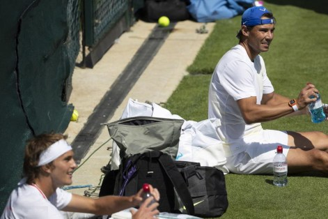 epa07677313 Rafael Nadal of Spain, right, and Alexander Zverev of Germany take a break during a training session at the All England Lawn Tennis Championships in Wimbledon, London, on Thursday, June 27, 2019. EPA-EFE/PETER KLAUNZER EDITORIAL USE ONLY; NO SALES, NO ARCHIVES