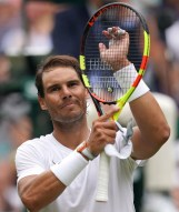 epa07699255 Rafael Nadal of Spain celebrates winning against Jo-Wilfried Tsonga of France during their third round match at the Wimbledon Championships at the All England Lawn Tennis Club, in London, Britain, 06 July 2019. EPA-EFE/WILL OLIVER EDITORIAL USE ONLY/NO COMMERCIAL SALES