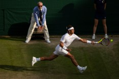 Rafael Nadal (ESP) in action in the quarter final of the Gentlemen's Singles on No.1 Court. The Championships 2019. Held at The All England Lawn Tennis Club, Wimbledon. Day 9 Wednesday 10/07/2019. Credit: AELTC/Tim Clayton