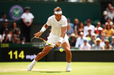 LONDON, ENGLAND - JULY 08: Rafael Nadal of Spain plays a backhand in his Men's Singles fourth round match against Joao Sousa of Portugal during Day Seven of The Championships - Wimbledon 2019 at All England Lawn Tennis and Croquet Club on July 08, 2019 in London, England. (Photo by Clive Brunskill/Getty Images)