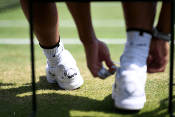 Rafael Nadal ties his shoe laces on day ten of the Wimbledon Championships at the All England Lawn Tennis and Croquet Club, Wimbledon. (Photo by Victoria Jones/PA Images via Getty Images)
