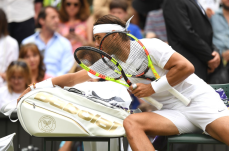 LONDON, ENGLAND - JULY 06: Rafael Nadal of Spain changes his racket between change of serve in his Men's Singles third round match against Jo-Wilfred Tsonga of France during Day six of The Championships - Wimbledon 2019 at All England Lawn Tennis and Croquet Club on July 06, 2019 in London, England. (Photo by Matthias Hangst/Getty Images)