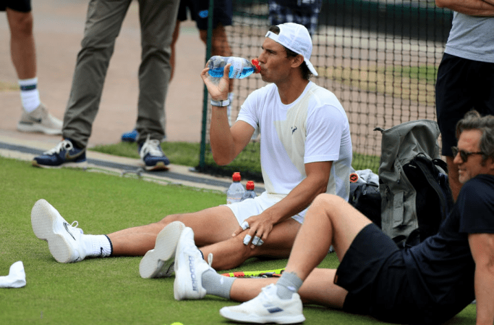 Rafael Nadal takes a break during a practice session on day eight of the Wimbledon Championships at the All England Lawn Tennis and Croquet Club, Wimbledon. (Photo by Mike Egerton/PA Images via Getty Images)