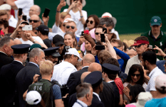 Rafael Nadal makes his way through the crowd of spectators after a practice session on day nine of the Wimbledon Championships at the All England Lawn Tennis and Croquet Club, Wimbledon. (Photo by Steven Paston/PA Images via Getty Images)