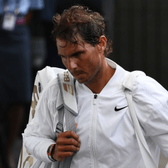 Spain's Rafael Nadal leaves the court after being beaten by Switzerland's Roger Federer during their men's singles semi-final match on day 11 of the 2019 Wimbledon Championships at The All England Lawn Tennis Club in Wimbledon, southwest London, on July 12, 2019. (Photo by Daniel LEAL-OLIVAS / AFP) / RESTRICTED TO EDITORIAL USE (Photo credit should read DANIEL LEAL-OLIVAS/AFP/Getty Images)