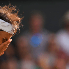 Spain's Rafael Nadal wipes his face after a point against Switzerland's Roger Federer during their men's singles semi-final match on day 11 of the 2019 Wimbledon Championships at The All England Lawn Tennis Club in Wimbledon, southwest London, on July 12, 2019. (Photo by Ben STANSALL / AFP) / RESTRICTED TO EDITORIAL USE (Photo credit should read BEN STANSALL/AFP/Getty Images)