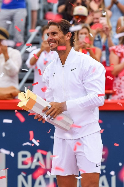 MONTREAL, QC - AUGUST 11: Rafael Nadal (ESP) looks at the crowd holding his winner trophy under a shower of confettis after the ATP Coupe Rogers final match on August 11, 2019 at IGA Stadium in Montreal, QC (Photo by David Kirouac/Icon Sportswire via Getty Images)