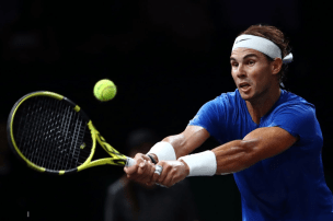 GENEVA, SWITZERLAND - SEPTEMBER 21: Rafael Nadal of Team Europe plays a backhand in his singles match against Milos Raonic of Team World during Day Two of the Laver Cup 2019 at Palexpo on September 21, 2019 in Geneva, Switzerland. The Laver Cup will see six players from the rest of the World competing against their counterparts from Europe. Team World is captained by John McEnroe and Team Europe is captained by Bjorn Borg. The tournament runs from September 20-22. (Photo by Julian Finney/Getty Images for Laver Cup)