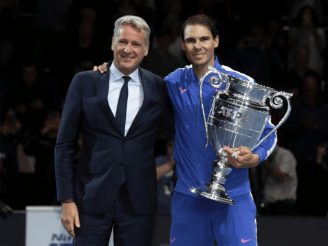 LONDON, ENGLAND - NOVEMBER 15: Rafael Nadal of Spain poses with Chris Kermode, CEO and Chairman of ATP and his trophy after being announced as ATP Tour end of year world number one following his singles match against Stefanos Tsitsipas of Greece during Day Six of the Nitto ATP World Tour Finals at The O2 Arena on November 15, 2019 in London, England. (Photo by Julian Finney/Getty Images)
