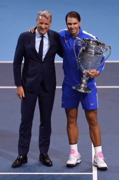 LONDON, ENGLAND - NOVEMBER 15: Rafael Nadal of Spain poses with his trophy with Chris Kermode, CEO of the ATP, after being announced as ATP Tour end of year world number one following his singles match against Stefanos Tsitsipas of Greece during Day 6 of the Nitto ATP World Tour Finals at The O2 Arena on November 15, 2019 in London, England. (Photo by Justin Setterfield/Getty Images)