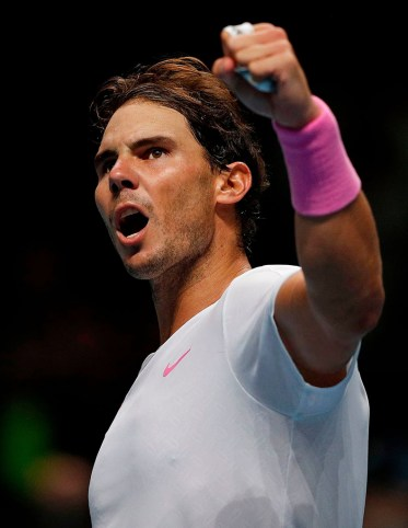 Spain's Rafael Nadal celebrates winning against Russia's Daniil Medvedev during their men's singles round-robin match on day four of the ATP World Tour Finals tennis tournament at the O2 Arena in London on November 13, 2019. - Nadal won 6-7, 6-3, 7-6. (Photo by Adrian DENNIS / AFP) (Photo by ADRIAN DENNIS/AFP via Getty Images)