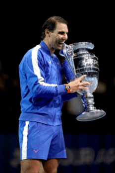 Rafael Nadal with his ATP World Number 1 trophy after winning his singles match against Stefanos Tsitsipas on day six of the Nitto ATP Finals at The O2 Arena, London. (Photo by John Walton/PA Images via Getty Images)