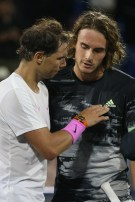 Spain's Rafael Nadal (L) speaks with Greece's Stefanos Tsitsipas after the Mubadala World Tennis Championship Final at Zayed Sports City in Abu Dhabi, on December 21, 2019. (Photo by - / AFP) (Photo by -/AFP via Getty Images)