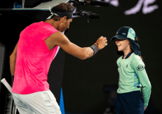 MELBOURNE, AUSTRALIA - JANUARY 23: Rafael Nadal of Spain makes sure a ball kid is okay after he hit her with the ball in his second round match against Fredrico Delbonis of Argentina on day four of the 2020 Australian Open at Melbourne Park on January 23, 2020 in Melbourne, Australia. (Photo by TPN/Getty Images)