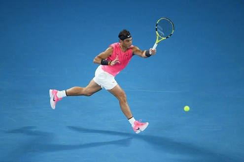 MELBOURNE, AUSTRALIA - JANUARY 23: Rafael Nadal of Spain plays a forehand during his Men's Singles second round match against Federico Delbonis of Argentina on day four of the 2020 Australian Open at Melbourne Park on January 23, 2020 in Melbourne, Australia. (Photo by Quinn Rooney/Getty Images)
