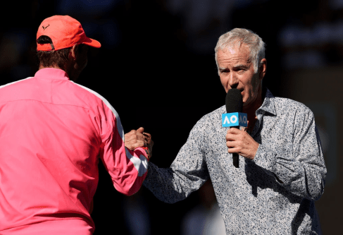 MELBOURNE, AUSTRALIA - JANUARY 25: Rafael Nadal of Spain speaks with John McEnroe on court after winning his Men's Singles third round match against Pablo Carreno Busta of Spain on day six of the 2020 Australian Open at Melbourne Park on January 25, 2020 in Melbourne, Australia. (Photo by Clive Brunskill/Getty Images)