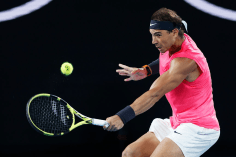 MELBOURNE, AUSTRALIA - JANUARY 29: Rafael Nadal of Spain plays a backhand during his Men's Singles Quarterfinal match against Dominic Thiem of Austria on day ten of the 2020 Australian Open at Melbourne Park on January 29, 2020 in Melbourne, Australia. (Photo by Darrian Traynor/Getty Images)