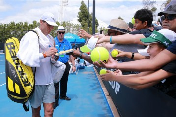 MELBOURNE, AUSTRALIA - JANUARY 26: Rafael Nadal of Spain signs autographs for fans after his practice session on day seven of the 2020 Australian Open at Melbourne Park on January 26, 2020 in Melbourne, Australia. (Photo by Wayne Taylor/Getty Images)