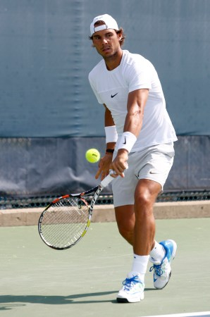 Rafael Nadal, of Spain, returns a shot during practice at the Western & Southern Open tennis tournament, Monday, Aug. 17, 2015, in Mason, Ohio. (AP Photo/David Kohl)