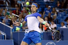Rafael Nadal, of Spain, returns to Jeremy Chardy, of France, during a match at the Western & Southern Open tennis tournament, Thursday, Aug. 20, 2015, in Mason, Ohio. (AP Photo/John Minchillo)