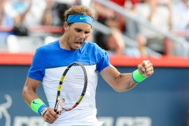 MONTREAL, ON - AUGUST 12: Rafael Nadal of Spain celebrates his victory against Sergiy Stakhovsky of Ukraine during day three of the Rogers Cup at Uniprix Stadium on August 12, 2015 in Montreal, Quebec, Canada. Rafael Nadal defeated Sergiy Stakhovsky 7-6, 6-3. (Photo by Minas Panagiotakis/Getty Images)