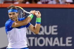 MONTREAL, ON - AUGUST 14: Rafael Nadal of Spain hits a return against Kei Nishikori of Japan during day five of the Rogers Cup at Uniprix Stadium on August 14, 2015 in Montreal, Quebec, Canada. (Photo by Minas Panagiotakis/Getty Images)