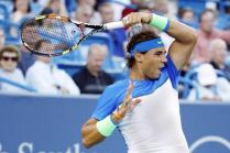 Rafael Nadal, of Spain, returns to Feliciano Lopez, of Spain, during a match at the Western & Southern Open tennis tournament, Thursday, Aug. 20, 2015, in Mason, Ohio. (AP Photo/John Minchillo)