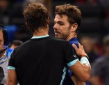 Rafael Nadal of Spain (L) and Stanislas Wawrinka of Switzerland shake hands after their men's singles quarter-final match at the Shanghai Masters tennis tournament in Shanghai on October 16, 2015. AFP PHOTO / JOHANNES EISELE