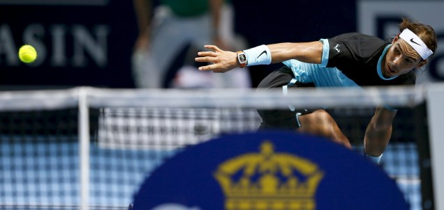 Rafael Nadal of Spain returns the ball to France's Richard Gasquet during their semi-final match at the Swiss Indoors ATP men's tennis tournament in Basel, Switzerland, October 31, 2015. REUTERS/Arnd Wiegmann