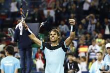 El tenista español Rafa Nadal reacciona ante el canadiense Milos Raonic durante el partido que ha enfrentado a ambos en el torneo de Shanghái en China hoy, 15 de octubre de 2015. EFE/Rolex Dela Pena
