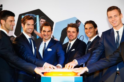 Novak Djokovic of Serbia, Andy Murray of Great Britain, Roger Federer of Switzerland, Stan Wawrinka of Switzerland, Rafael Nadal of Spain and Tomas Berdych of Czech Republic prepare to launch the Vixlet app during the Barclays ATP World Tour Finals Draw at City Hall on November 12, 2015 in London, England. (Nov. 11, 2015 - Source: Julian Finney/Getty Images Europe)