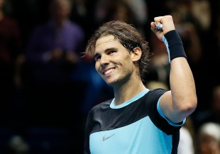 Rafael Nadal of Spain celebrates at match point after defeating Andy Murray of Britain during their singles tennis match at the ATP World Tour Finals at the O2 Arena in London, Wednesday, Nov. 18, 2015. (AP Photo/Kirsty Wigglesworth)