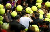 Spain's Rafael Nadal of the Indian Aces, center, gives his autographs to Filipino fans following his game against Czech Republic's Tomas Berdych of the UAE Royals in the men's singles in the 2015 International Premier Tennis League Monday, Dec. 7, 2015 at the Mall of Asia Arena in suburban Pasay city, south of Manila, Philippines. Nadal won over Berdych 6-5. (AP Photo/Bullit Marquez)