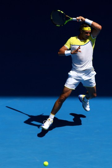 MELBOURNE, AUSTRALIA - JANUARY 19: Rafael Nadal of Spain plays a forehand in his first round match against Fernando Verdasco of Spain during day two of the 2016 Australian Open at Melbourne Park on January 19, 2016 in Melbourne, Australia. (Photo by Ryan Pierse/Getty Images)