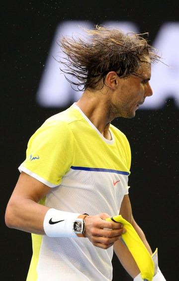 MELBOURNE, AUSTRALIA - JANUARY 19: Rafael Nadal of Spain removes his sweatband after losing his first round match against Fernando Verdasco of Spain during day two of the 2016 Australian Open at Melbourne Park on January 19, 2016 in Melbourne, Australia. (Photo by Michael Dodge/Getty Images)