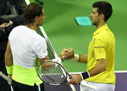 Novak Djokovic of Serbia (R) shakes hands with Rafael Nadal of Spain after their Qatar Open men's single tennis final match in Doha, Qatar January 9, 2016. REUTERS/Ibraheem Al Omari