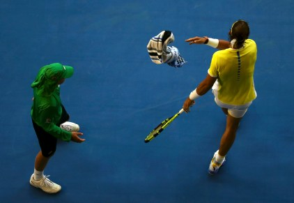 Spain's Rafael Nadal throws his towel to a ball boy during his first round match against Spain's Fernando Verdasco at the Australian Open tennis tournament at Melbourne Park, Australia, January 19, 2016. REUTERS/Jason O'Brien