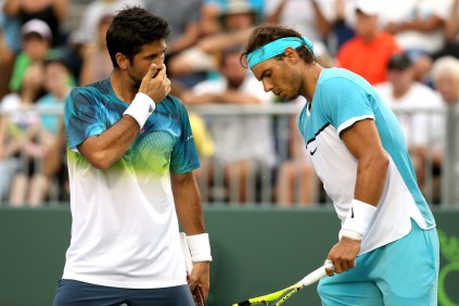 Fernando Verdasco and Rafael Nadal of Spain confer between points while playing Simone Bolelli and Andreas Seppi of Italy during the Miami Open presented by Itau at Crandon Park Tennis Center on March 24, 2016 in Key Biscayne, Florida. (March 23, 2016 - Source: Matthew Stockman/Getty Images North America)