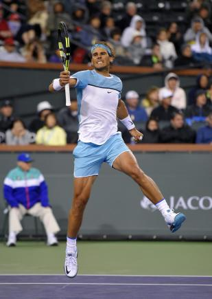 Rafael Nadal, of Spain, celebrates after defeating Gilles Muller, of Luxembourg at the BNP Paribas Open tennis tournament, Sunday, March 13, 2016, in Indian Wells, Calif. Nadal won 6-2, 2-6, 6-4. (AP Photo/Mark J. Terrill)