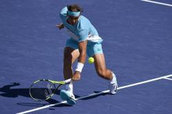 Rafael Nadal, of Spain, returns to Kei Nishikori, of Japan, during their quarterfinal match at the BNP Paribas Open tennis tournament, Friday, March 18, 2016, in Indian Wells, Calif. (AP Photo/Mark J. Terrill)