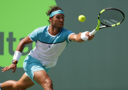 Rafael Nadal, of Spain, returns to Damir Dzumhur during their match at the Miami Open tennis tournament, Saturday, March 26, 2016, in Key Biscayne, Fla. (AP Photo/Lynne Sladky)