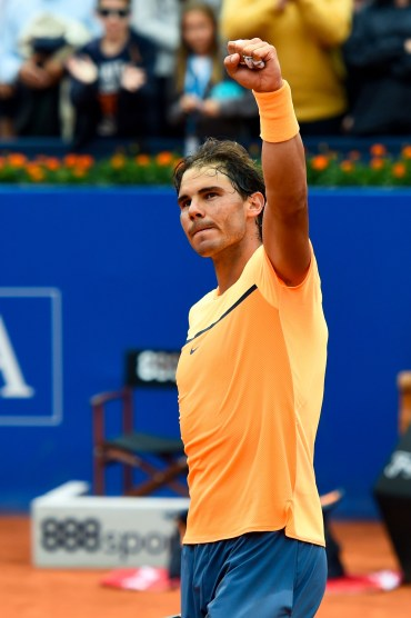 BARCELONA, SPAIN - APRIL 22: Rafael Nadal of Spain celebrates defeating Fabio Fognini of Italy during day five of the Barcelona Open Banc Sabadell at the Real Club de Tenis Barcelona on April 22, 2016 in Barcelona, Spain. Nadal won 6-2, 7-5. (Photo by David Ramos/Getty Images)