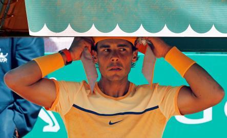 Tennis - Monte Carlo Masters - Monaco, 15/04/2016. Rafael Nadal of Spain adjusts his headband during his match against Stan Wawrinka of Switzerland. REUTERS/Eric Gaillard