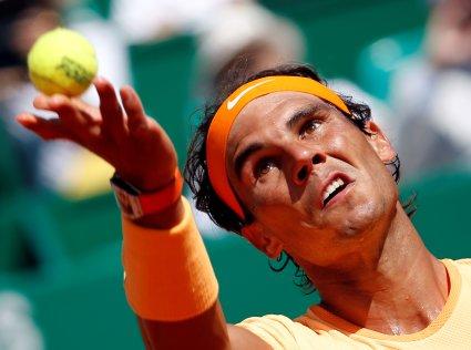 Tennis - Monte Carlo Masters - Monaco, 13/04/2016. Rafael Nadal of Spain serves to Aljaz Bedene of Britain. REUTERS/Eric Gaillard