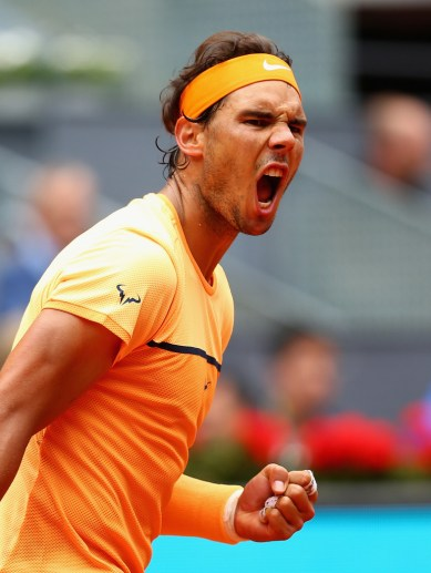 afael Nadal of Spain celebrates a point against Andy Murray of Great Britain in their semi final match during day eight of the Mutua Madrid Open tennis tournament at the Caja Magica on May 07, 2016 in Madrid,Spain. (May 6, 2016 - Source: Clive Brunskill/Getty Images Europe)